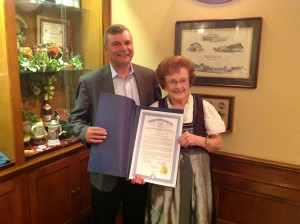Bill Rustem, Director of Strategy for Governor Rick Snyder, presents Dorothy Zehnder with the special tribute.